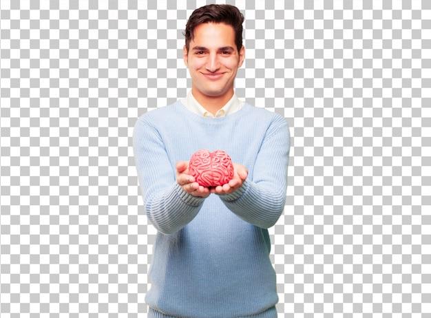 Giovane uomo abbronzato con un modello di cervello
