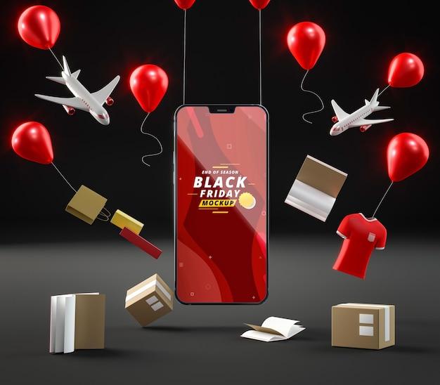 Globos de venta emergente y teléfono móvil sobre fondo negro