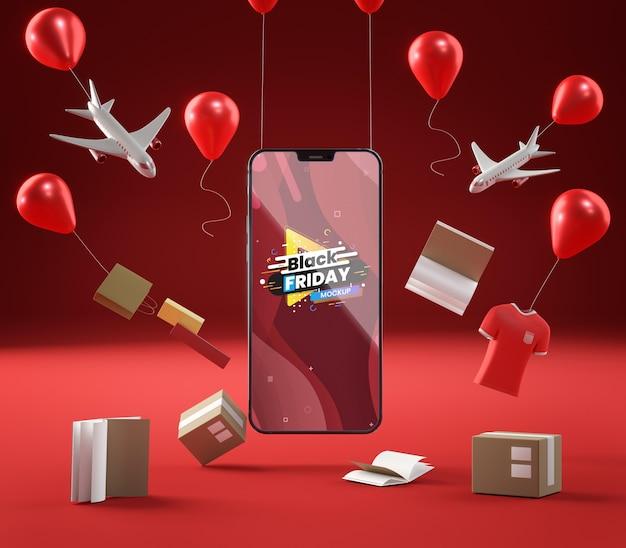 Globos de venta emergente y teléfono móvil sobre fondo rojo.