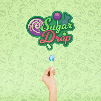 Goccia di zucchero con mano e doodle sfondo verde