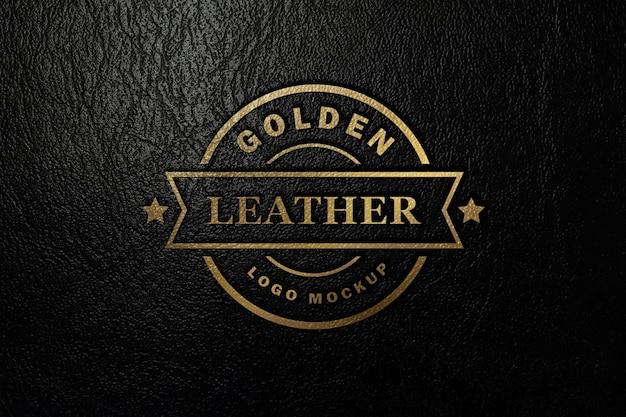 Gouden logo mockup gestempeld op zwart kunstleer