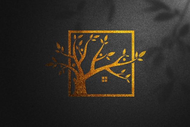 Gouden mockup logo zwart papier