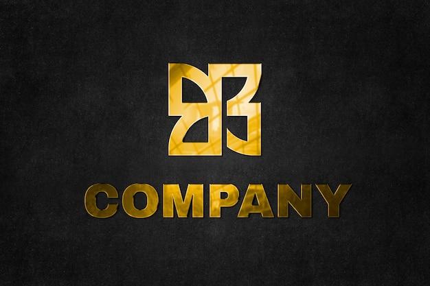 Grabe la maqueta del logotipo psd en oro para la empresa con el texto de la línea de etiqueta aquí