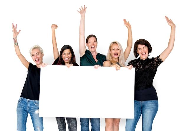 Groep van vrouwelijk show present blank board