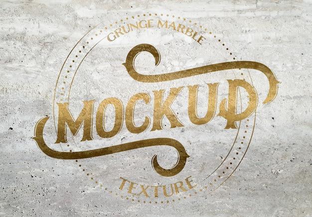 Grunge marmeren textuur met gouden afgeschuind effect mockup