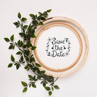 Guarde la maqueta de fecha con marco de hojas