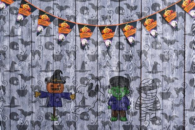 Guirnalda de halloween con calabaza espantapájaros y frankenstein