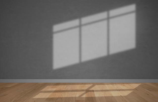 Habitación vacía con un fondo de maqueta de pared gris