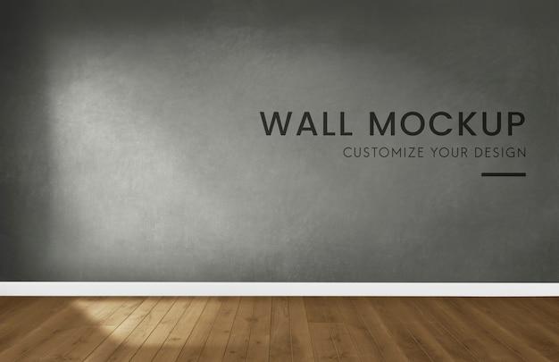 Habitación vacía con una maqueta de pared gris oscuro