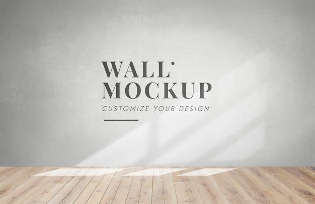 Habitación vacía con una maqueta de pared gris