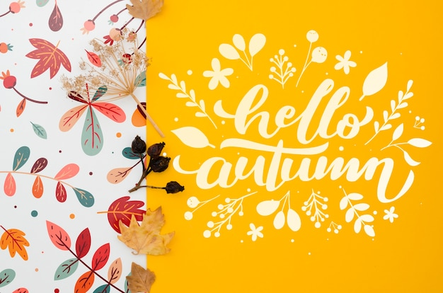 Hallo herfst belettering op gele achtergrond