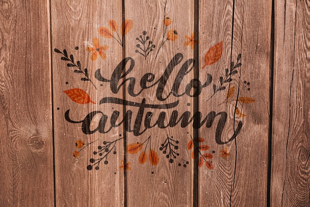 Hallo herfst geschreven op een houten achtergrond