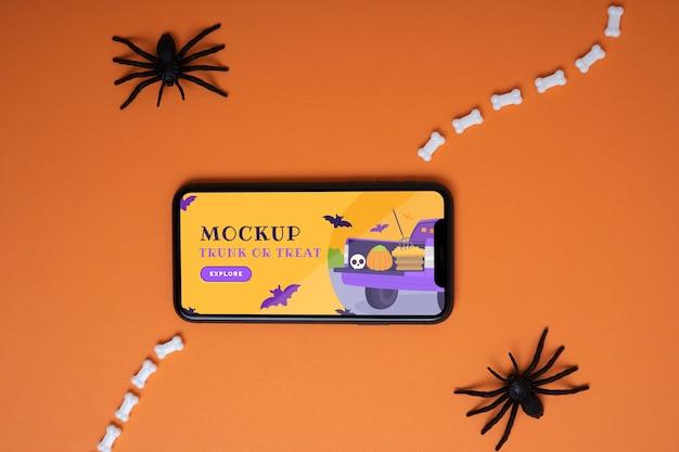 Halloween-arrangement met mock-up smartphonescherm