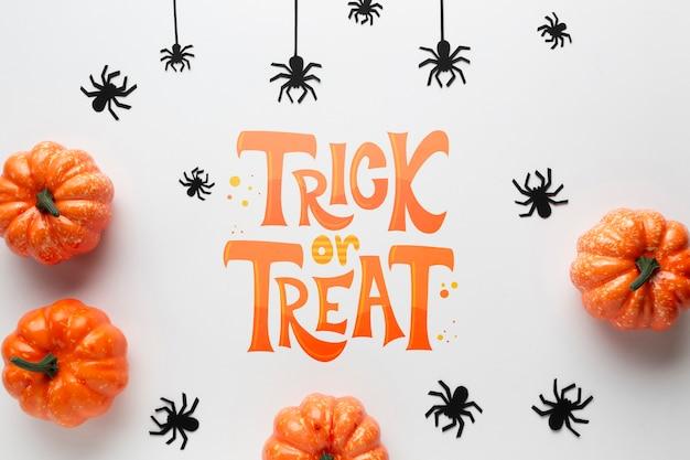Halloween-kader met pompoenen en spinnen