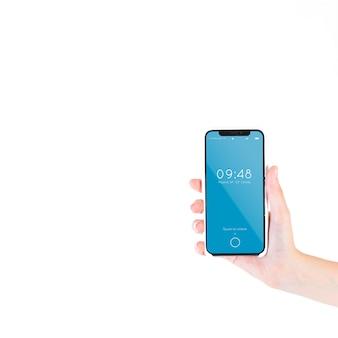 Hand met smartphone mockup