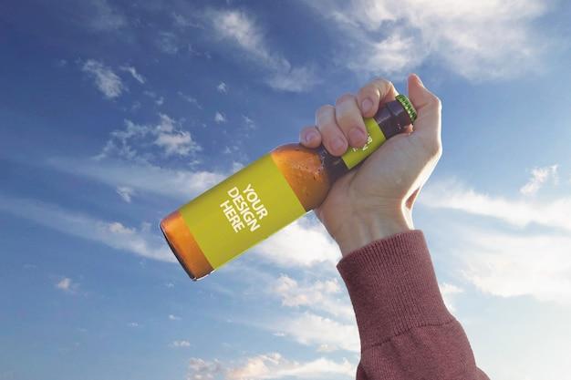 Hand sky beer mockup