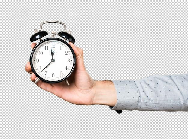 Hand van de man met vintage klok