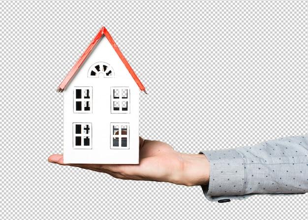 Hand van de mens met een klein huis