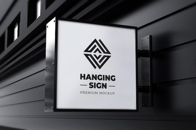 Hangende teken mockup buiten vierkante neonbox zwart wit