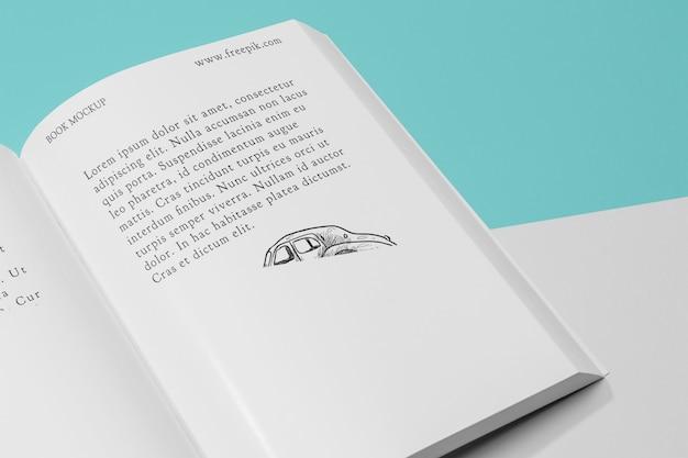 Hoge hoek open boek mock-up met illustratie