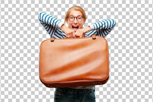 Hogere mooie vrouw met een koffer van het leergeval