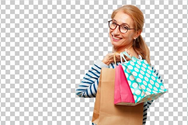Hogere mooie vrouw met het winkelen zakken