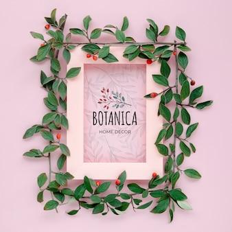 Hojas botánicas y marco con maqueta