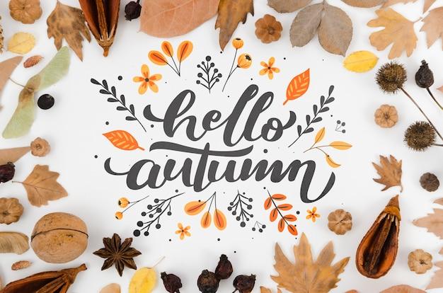 Hojas coloridas que rodean las letras de otoño hola