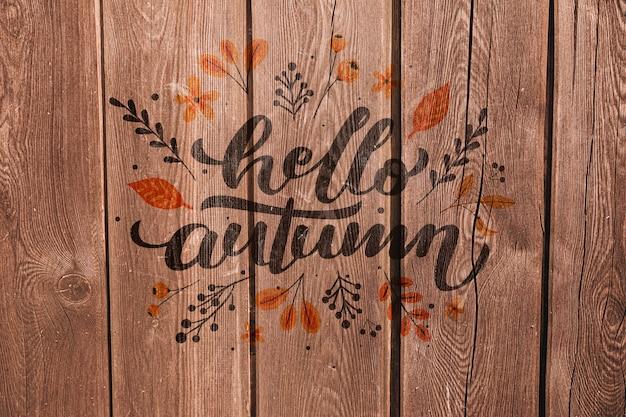 Hola otoño escrito sobre un fondo de madera