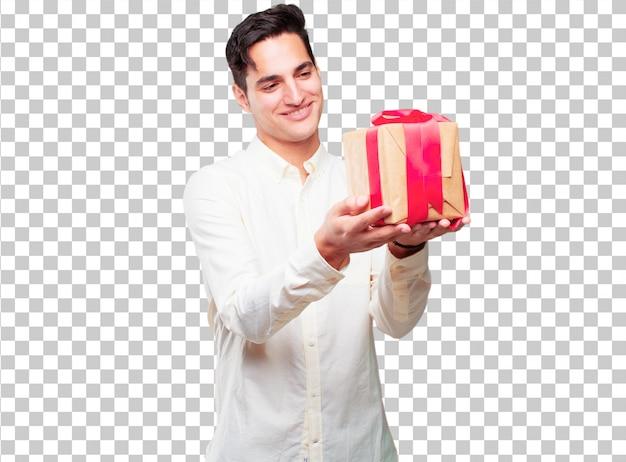 Hombre bronceado hermoso joven con concepto de la caja de regalo