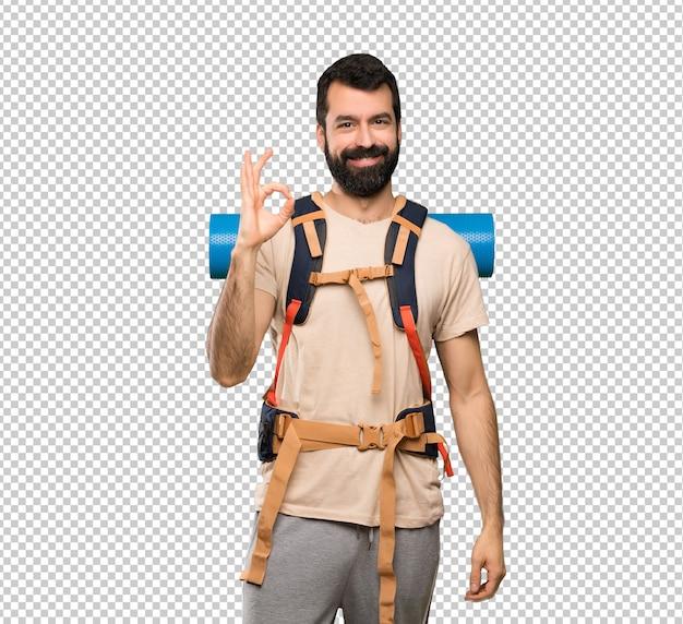 Hombre caminante que muestra la muestra aceptable con los dedos