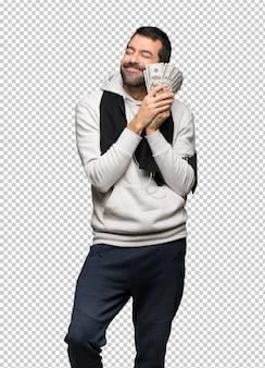 Hombre de deporte tomando mucho dinero