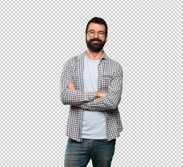 Hombre guapo con barba con gafas y feliz.