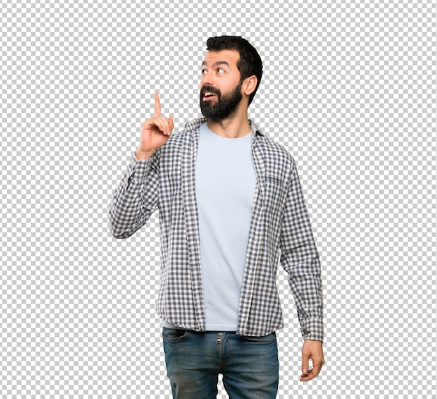 Hombre guapo con barba pensando una idea apuntando el dedo hacia arriba