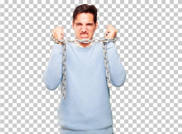 Hombre guapo joven con una cadena. concepto de libertad