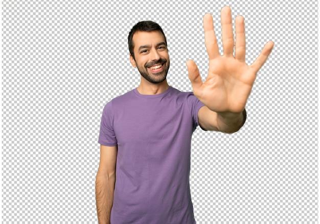 Hombre guapo saludando con la mano con expresión feliz