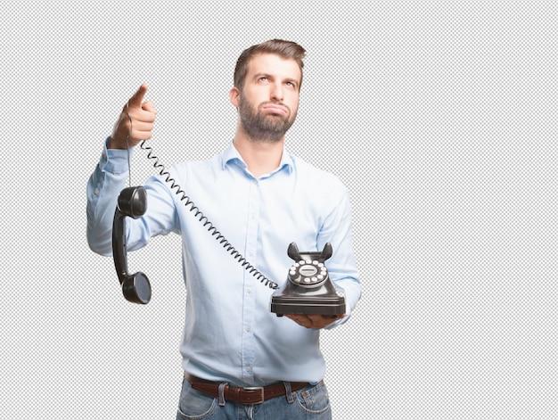 Hombre con teléfono retro