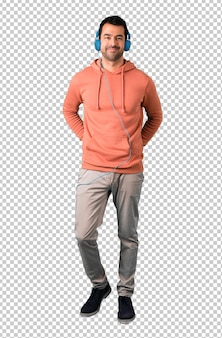 Homem, em, um, cor-de-rosa, sweatshirt, escutar música, com, fones