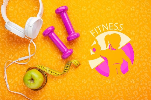 Hoofdtelefoon met gewichten en appel