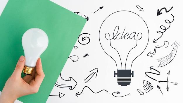 Idea di concetto di doodle con schizzi di lampadina
