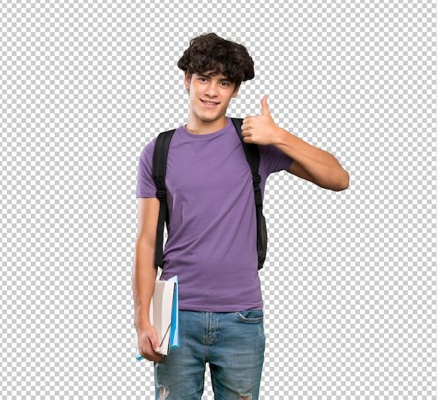 Il giovane uomo dello studente con i pollici aumenta il gesto e sorridere