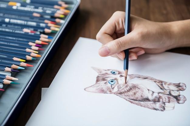 Illustrationist che colora il concetto animale adorabile dell'area di lavoro