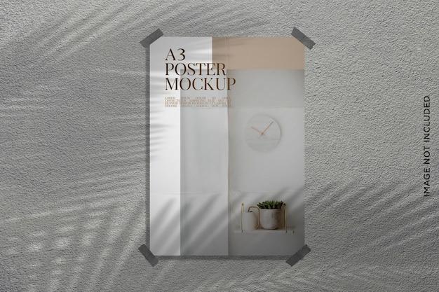 Impresión de maqueta de póster en la pared con sombra de hoja
