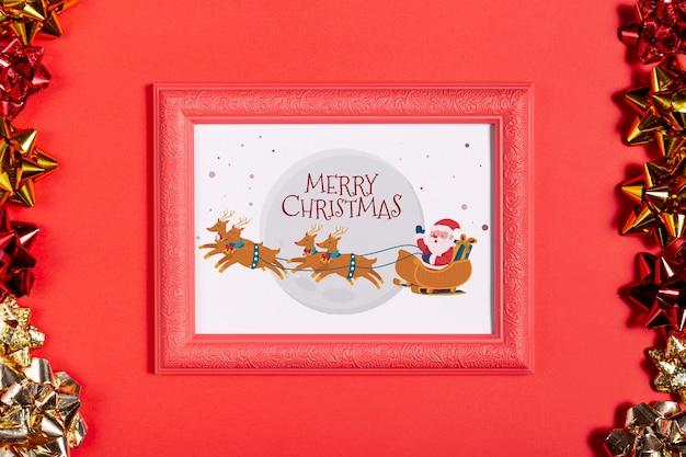 Ingelijste kerstman en zijn rendierenfoto met trekbogen
