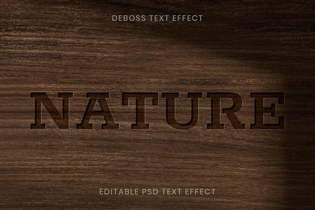 Ingeslagen teksteffect psd bewerkbare sjabloon op houten achtergrond
