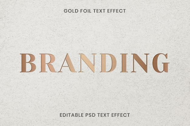 Ingeslagen teksteffect psd bewerkbare sjabloon op kraftpapier textur