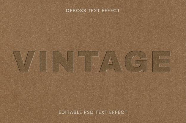 Ingeslagen teksteffect psd bewerkbare sjabloon op kraftpapier textuur achtergrond