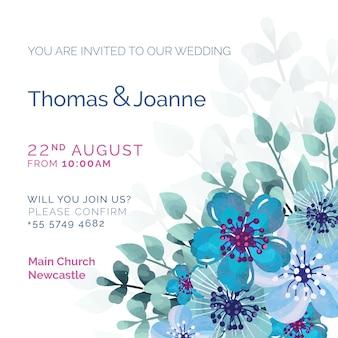 Invitación de boda blanca con flores pintadas de azul