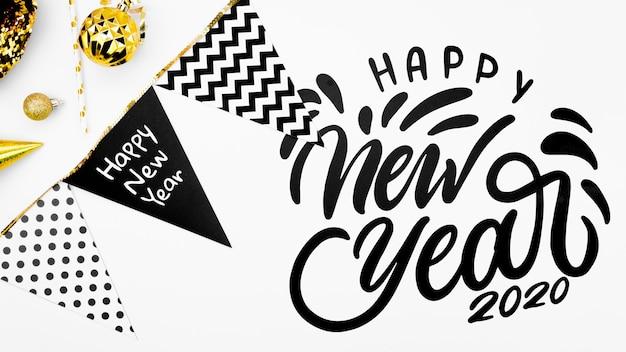 Iscrizione di felice anno nuovo con ghirlanda