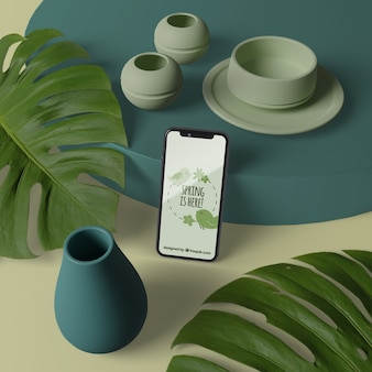 Jarrones 3d con flores al lado del teléfono con maqueta
